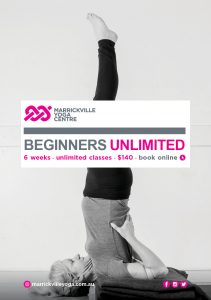 Beginners class teacher in Shoulder stand yoga pose.